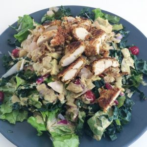 Coconut Breaded Chicken and Cranberry over Kale and Romaine Salad